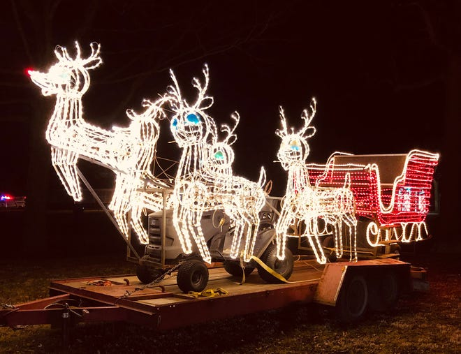 Santa's sleigh stood on a trailer as part of the Light Up parade held at Chautauqua Park Friday night. There were approximately 1,000 vehicles that drove around the park to view the floats that otherwise would have paraded in the downtown area.