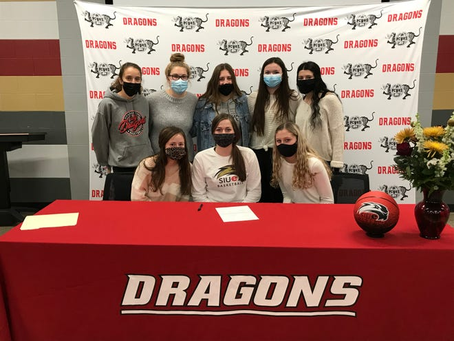 Pekin girls basketball teammates support Taylor Goss as she signs with Southern Illinois-Edwardsville. In back from left are Lily Wagemann, Tess Cascia, Natalie Righi, Ainsley Hall and Laura Gilmore. In front from left are Leah McClanahan, Goss and Sami Diekhoff.