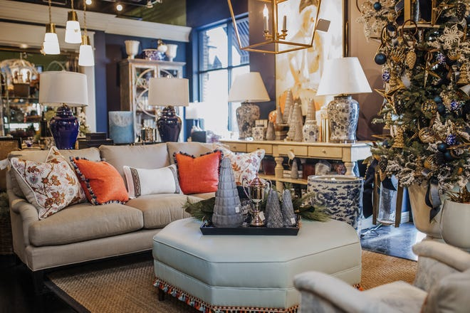 Warm and light furniture offsets navy walls, culminating in a beautifully blue holiday display.