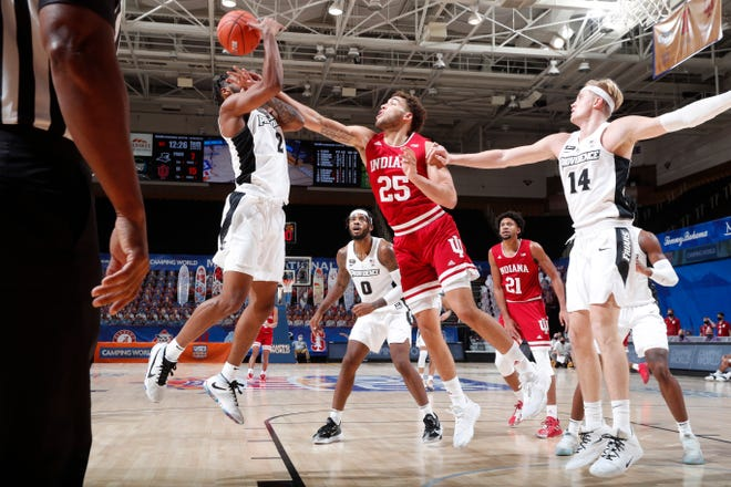 Indiana's Race Thompson gets a hand in the face of PC's Kris Monroe during first-half action in Maui Invitational on Monday.