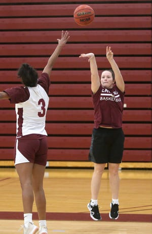 Morgan McMillen (right) takes a shot while being defended by Payton Pooler (3) during practice at Walsh University on Monday, Nov. 30, 2020.