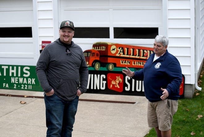 Erik Indorf of Massillon and his dad, Rick, have turned a hobby into a lucrative business as collectors and dealers of vintage signs.