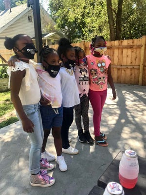 Members of Girl Scouts Troop 1347 meet over the summer. Photo courtesy LaTisha Marks.