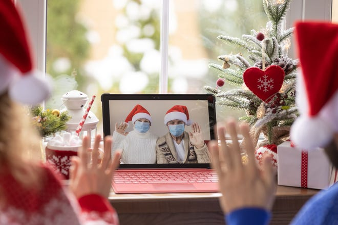 REMOTE CELEBRATING: This year many families will need to make do with virtual holiday cheer, while hoping that next year our troubles will be out of sight. (Yarruta/dreamstime.com)