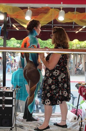 """Artists applied paint to the bodies of models at the 2019 """"Your Body My Canvass"""" Art Hops event on Miner Street in Yreka."""