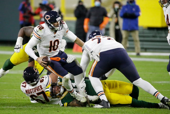 Chicago Bears' Mitchell Trubisky is sacked by Green Bay Packers' Preston Smith during the second half of an NFL football game Sunday, Nov. 29, 2020, in Green Bay, Wis.
