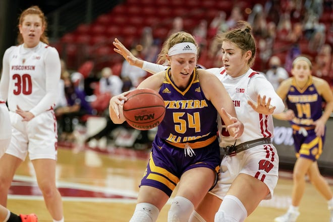 Western Illinois' Evan Zars (54) drives against Wisconsin's Julie Pospisilova (5) on Sunday, Nov. 29, 2020, in Madison, Wis.