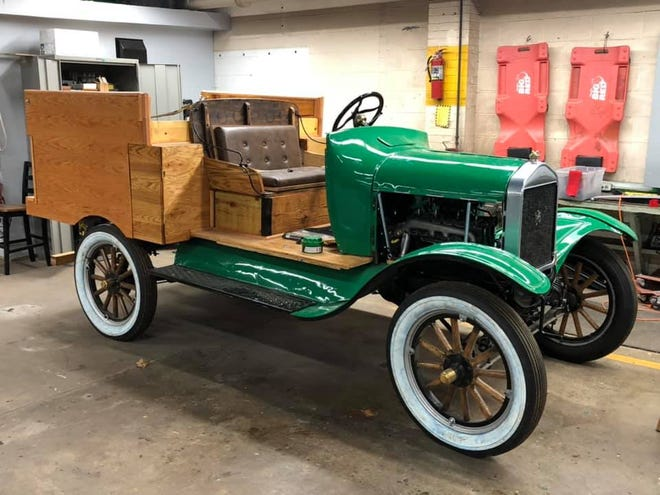 Bill Scott and Kate Rashid take the Wethersfield FFA model 5 test run Chapter's rebuilt 1924 Model T Ford farm truck for its first spin after it was rolled out of the ag shop where Scott, Gary Miller and ag mechanics students restored the vintage vehicle.