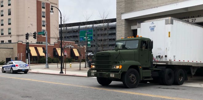 The Massachusetts National Guard delivered supplies to the DCU Center Monday morning. The convention center will be used as a field hospital.