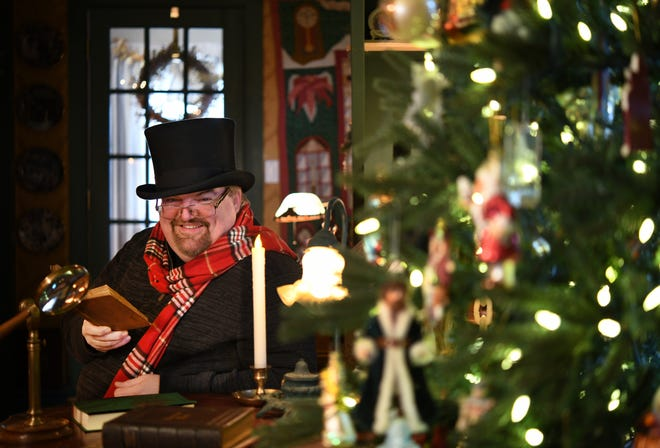 "Tim Kenny and his wife, Debbie, decorate their Main Street home with ""A Christmas Carol"" theme every holiday season, hoping to inspire ""charity, kindness, love and celebration."""