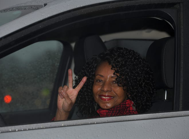 """Peace out!"" T&G reporter Elaine Thompson, who is retiring after almost 40 years as a journalist,  flashes a peace sign from her car in Marlboro Monday."