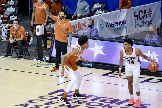 Texas head coach Shaka Smart calls a play from the sidelines during the Maui Invitational game against Davidson November 30, 2020 in Asheville.