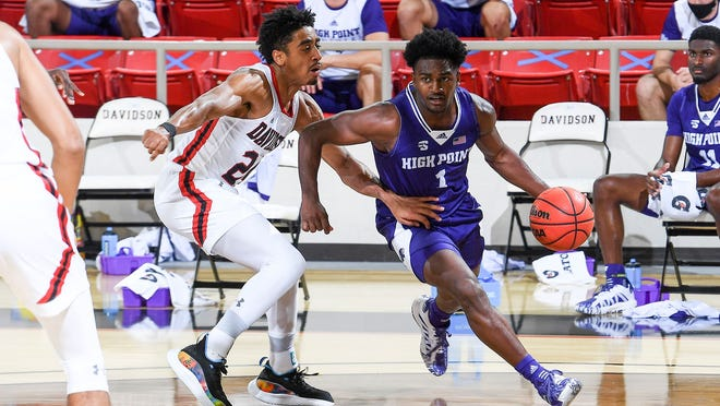 Fayetteville native John-Michael Wright (1) averaged 24.5 points per game for High Point in the opening week of the season.