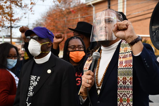 Rev. Gregory Drumwright (right) and North Carolina's NAACP President Dr. T. Anthony Spearman take part in a march through Graham on Sunday, Nov. 29, 2020.