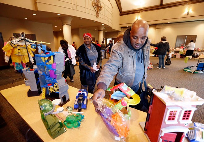People shop for toys during the Lazarus Toy Sale inside Christ Episcopal Church in Tuscaloosa on Wednesday, Dec. 11, 2013. [Staff file photo]