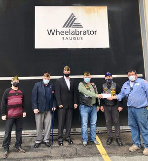 Veterans receiving the check from Wheelabrator Saugus include Carl Mucci of the VFW , Saugus VFW Quartermaster Stanley King, Saugus Veterans Service Officer Jay Pinette, Saugus VFW Commander Jim Marshall and Billy Boomer of the Saugus VFW.
