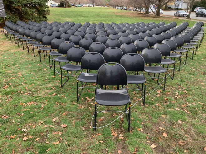 A memorial of black chairs was arranged last month on the lawn of City Hall in Newton in honor of city residents who have died from COVID-19.