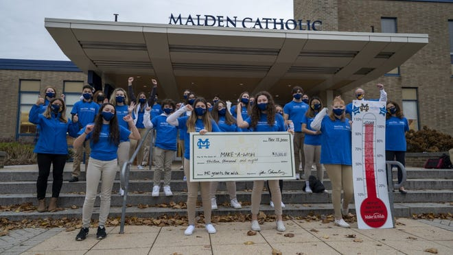 Malden Catholic's Make-A-Wish Club presented a check for $13,008 to Make-A-Wish Massachusetts and Rhode Island to create and support Ivan's Outdoor Sensory Oasis dream.