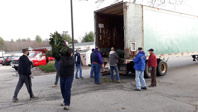 The Stow Lions unload Christmas trees on Nov. 21.