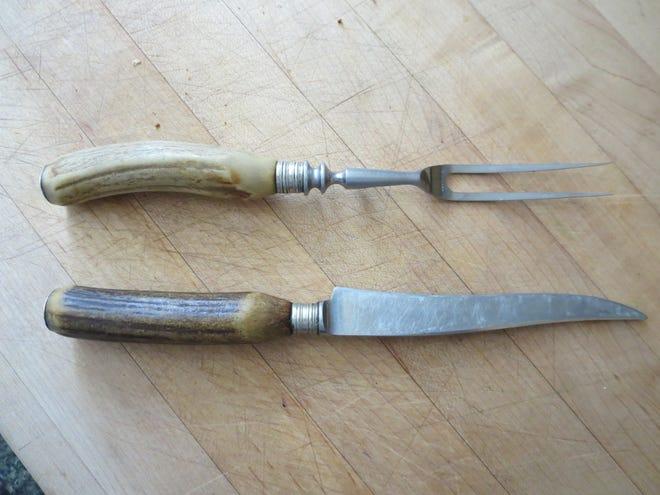 Stag antler handled carving knife and fork.