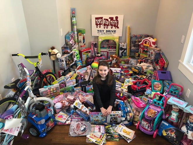Abigail Adams Middle School sixth-grader Sophie Ames hopes residents will support her gift collection efforts for the Marine Corp.'s Toys For Tots at Weymouth High School on Saturday, Dec. 5.
