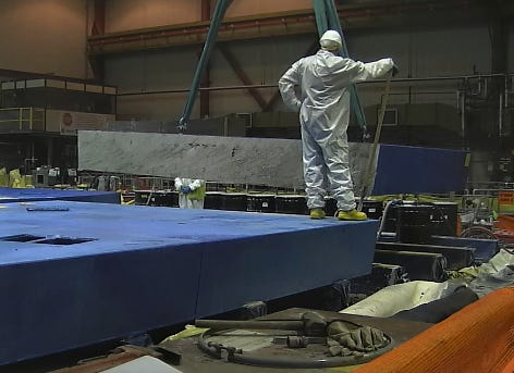 A portion of reactor shield is removed during decommissioning at Pilgrim Nuclear Power Station.
