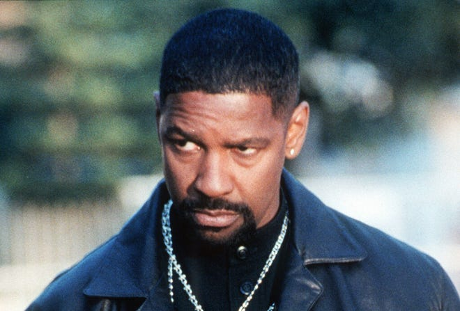 """Actor Denzel Washington stars in """"Training Day."""" Washington was named as the best actor of the 21st century (so far) by New York Times critics."""