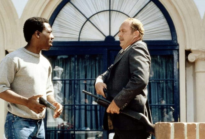 """Eddie Murphy, left, and John Ashton appear in  Beverly Hills Cop."""""""