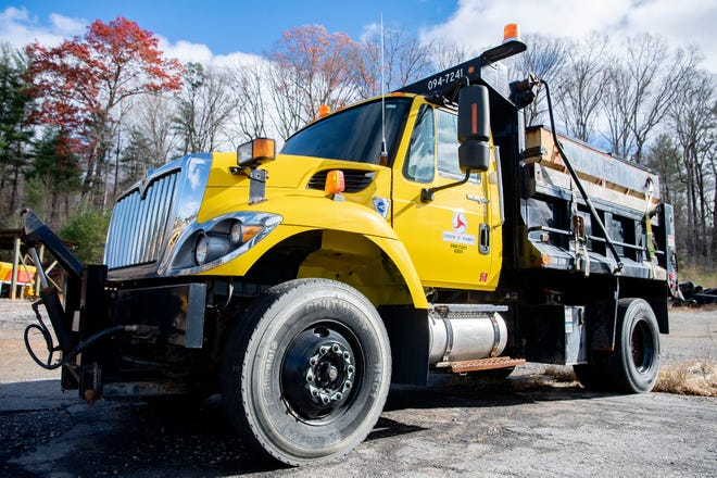 Workers with NCDOT prepare for forecasted snow at the  Buncombe County Maintenance Yard in this Nov. 30 file photo.