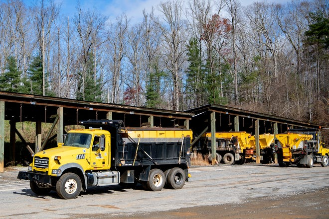 Workers with NCDOT prepare for forecasted snow at the  Buncombe County Maintenance Yard on Nov. 30, 2020. Trucks were filled with salt and fitted with plows as snow is expected overnight in high elevations.