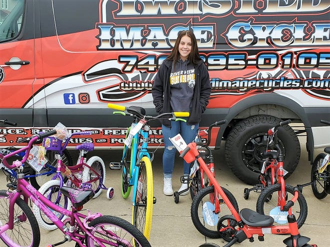 Adison Smith with some of the bicycles donated to the 2020 Coshocton County Miracle on Wheels Bicycle Giveaway. Her father, Mickey Smith of Twisted Image Cycle, said Adison came up with the idea last year.