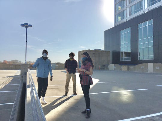 Choreographer Stephanie Miracle, composer Ramin Roshandel and writer/poet Steven Willis on top of the Chauncey Swan Parking Ramp.