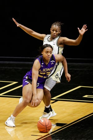 North Alabama guard Jaila Roberts (23) dribbles around Purdue guard Brooke Moore (0) during the third quarter of an NCAA women's basketball game, Sunday, Nov. 29, 2020 at Mackey Arena in West Lafayette.