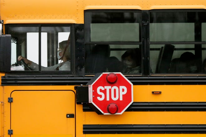 A bus arrives at Wyandotte Elementary School as Tippecanoe School Corp. returns to in-person instruction, Monday, Nov. 30, 2020 in Lafayette.