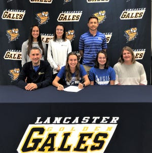 Lancaster's Kayla Day signs her letter of intent to further her education and to run track and cross country at Ohio University. front row, left to right, Jim Day, father, Kayla Day, Abby Day, sister and Amy Day, mother. Second row, L-R: Lancaster coach Dianna Galadyk and Teresa Tripp and Ohio Christian University coach Dr. Tim Sykes