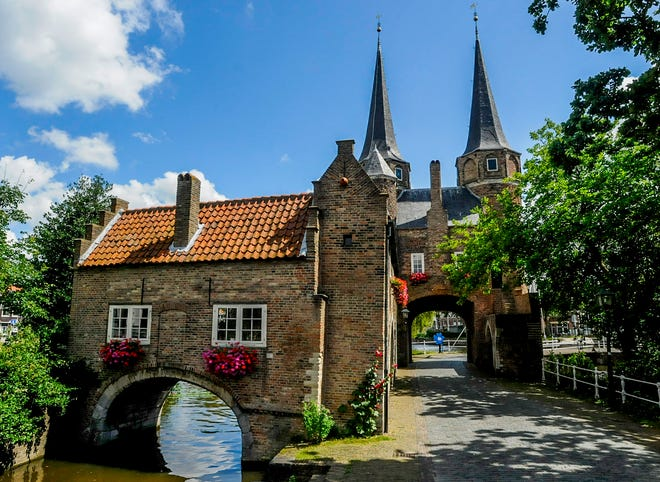 Riding our bikes into Delft through the East Gate.
