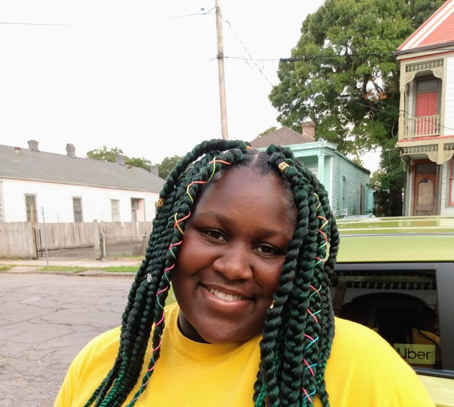 Joia' White, a senior at The Rooted School, is saving her weekly stipend for college or an unexpected finance.
