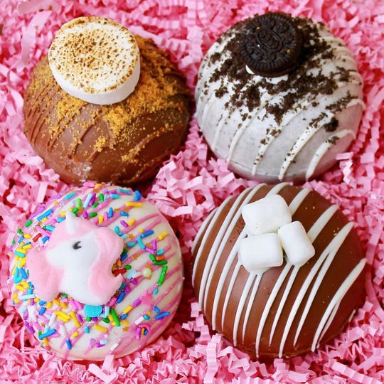 S'mores, Oreo, Unicorn and classic hot chocolate are some of the hot cocoa bomb flavors at Kara Kakes.