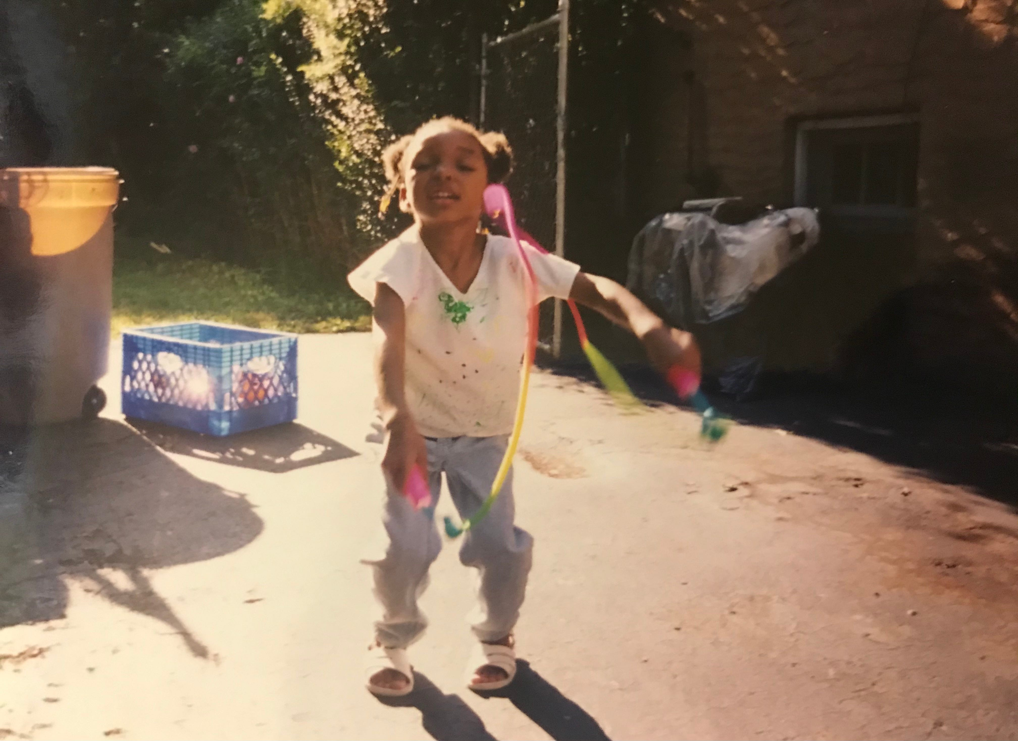Shaylah Brown jumping rope in the backyard of her grandparents' house in 1999.
