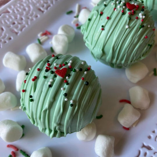 Trinka's Treats Grinch bomb comes topped with a tiny heart sprinkle.