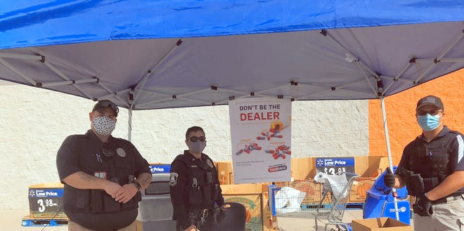 From left: Deming Police Department's Sergeant Standridge joins Lieutenant Detective Sergio Lara and Code Officer Ernie Jasso during Drug Take Back Day.