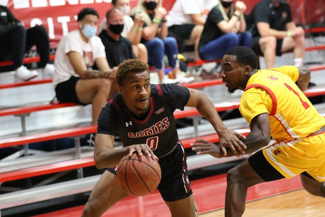 Junior point guard C.J. Roberts (left) blows past his defender during New Mexico State's season-opening game against Arizona Christian on Nov. 29, 2020, in Glendale, Arizona.
