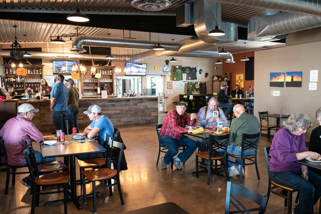 Lunch time at Guadalupe Mountain Brewing Company, in Carlsbad, shortly before a November emergency health order ended indoor dining statewide. To create social distance, fewer tables were available.