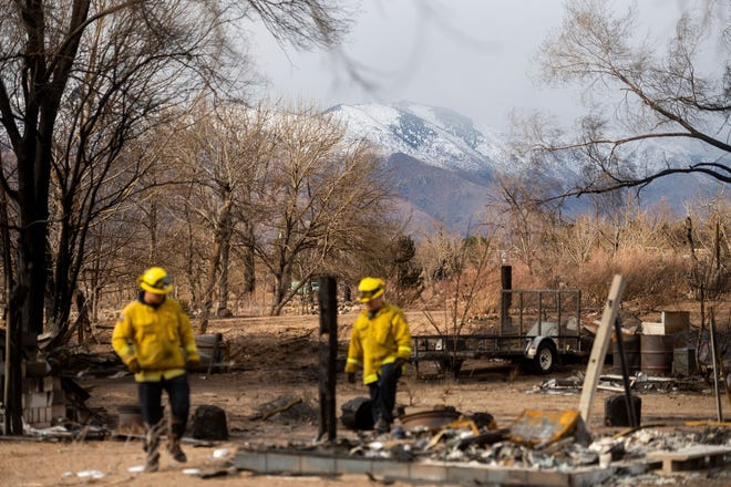 Firefighters sift through debris Wednesday, Nov. 18, 2020, to recover keepsakes for residents after the Mountain View Fire tore though the Walker community in Mono County.