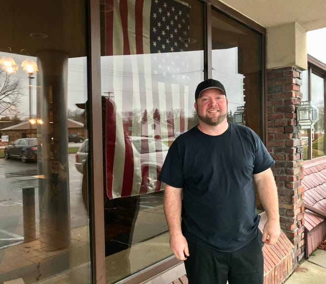 Troy Tank, manager of the former Sandusky Big Boy, poses for a photo in front of the restaurant on Nov. 30, 2020.