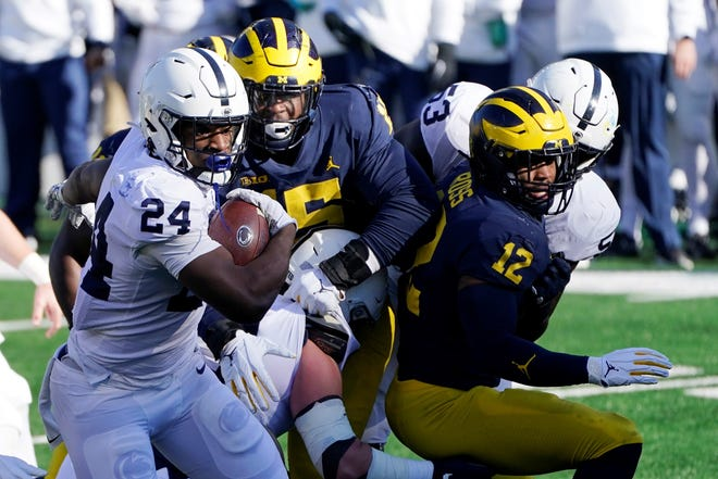 Penn State running back Keyvone Lee (24) rushes during the first half of an NCAA college football game against Michigan, Saturday, Nov. 28, 2020, in Ann Arbor, Mich. (AP Photo/Carlos Osorio)