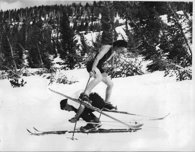 Marce Herz, circa 1938, jumps over a ski partner.