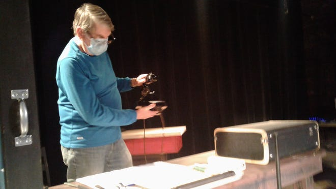 """Phil Baisley creates live sound effects during a rehearsal of """"It's a Wonderful Life: A Live Radio Play."""""""