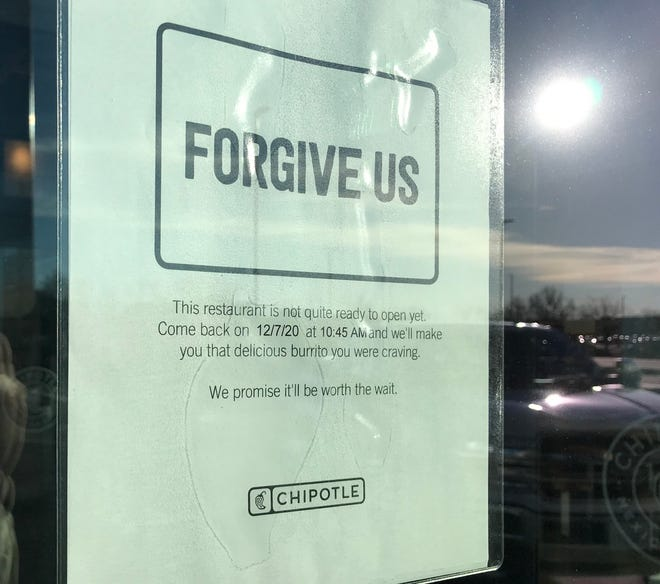 A sign posted on the windows of Chipotle Mexican Grill in Sioux Falls says the location will open Dec. 7.
