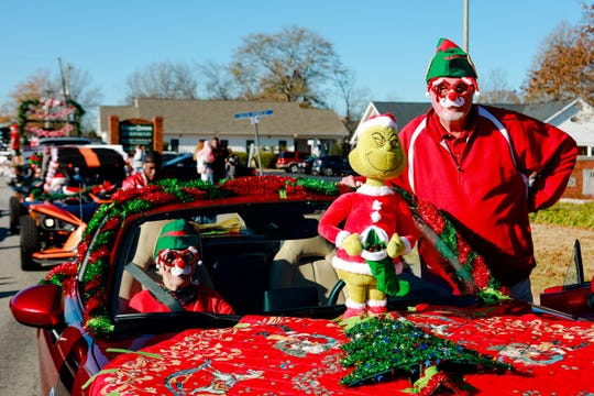 Linda Tabor and Jim Tabor hang out with the Grinch as the Simpsonville Christmas Parade made its way through Main Street, Sunday, December 1, 2019.